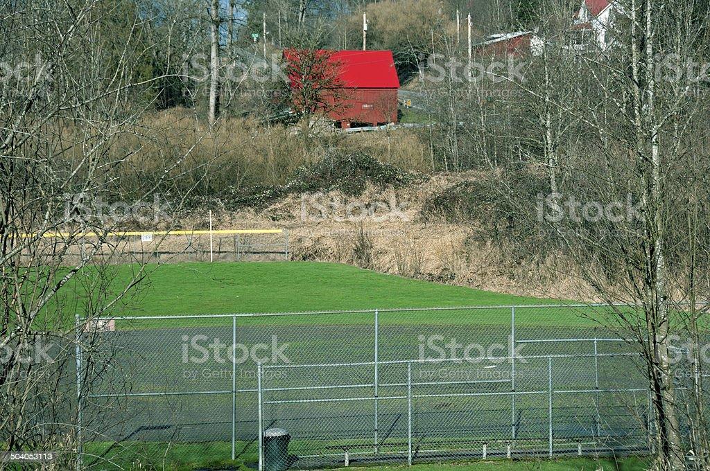 Baseball field and barn after rain storm in Washington state royalty-free stock photo