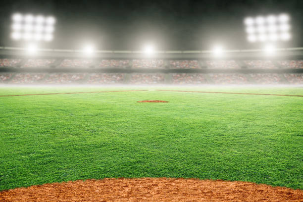 Baseball Field in Outdoor Stadium With Copy Space Baseball field at brightly lit fictitious outdoor stadium. Focus on foreground and shallow depth of field on background and copy space. Stadium created in Photoshop. baseball sport stock pictures, royalty-free photos & images