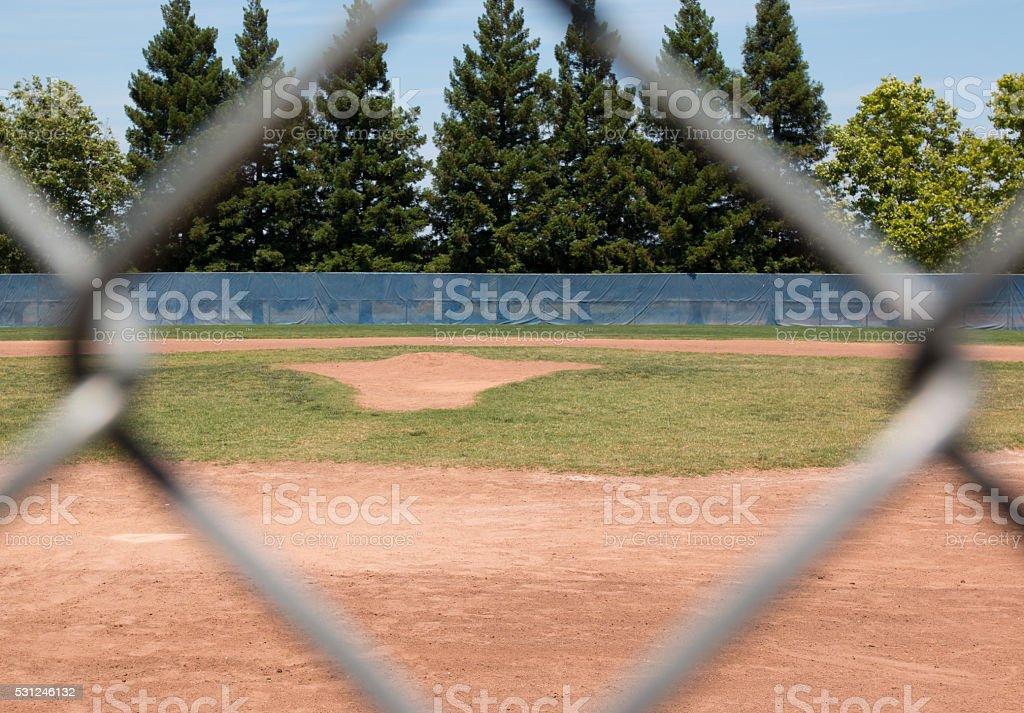 Baseball Field Through Fence stock photo