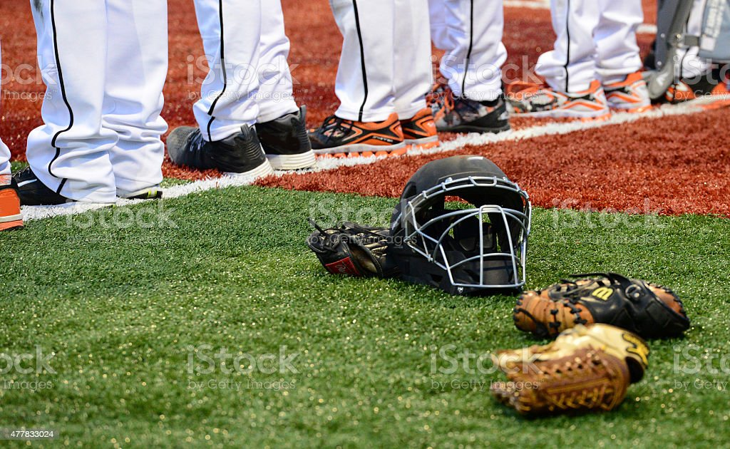 Baseball gear and baseball players' feet stock photo
