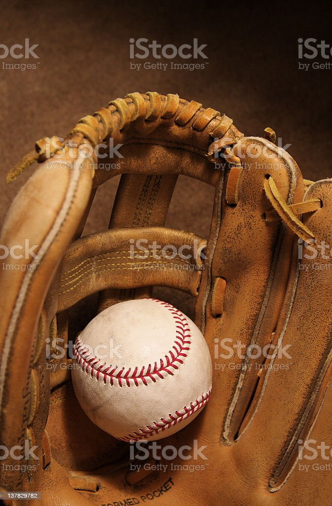 baseball glove catching a game used baseball