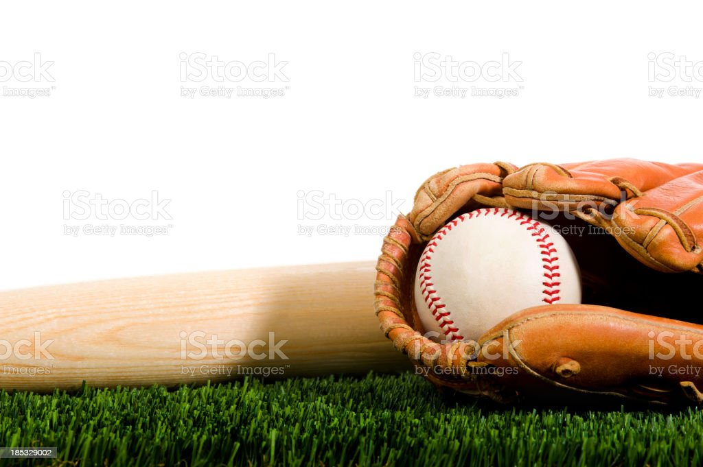 Baseball, glove and bat in Grass with white background stock photo