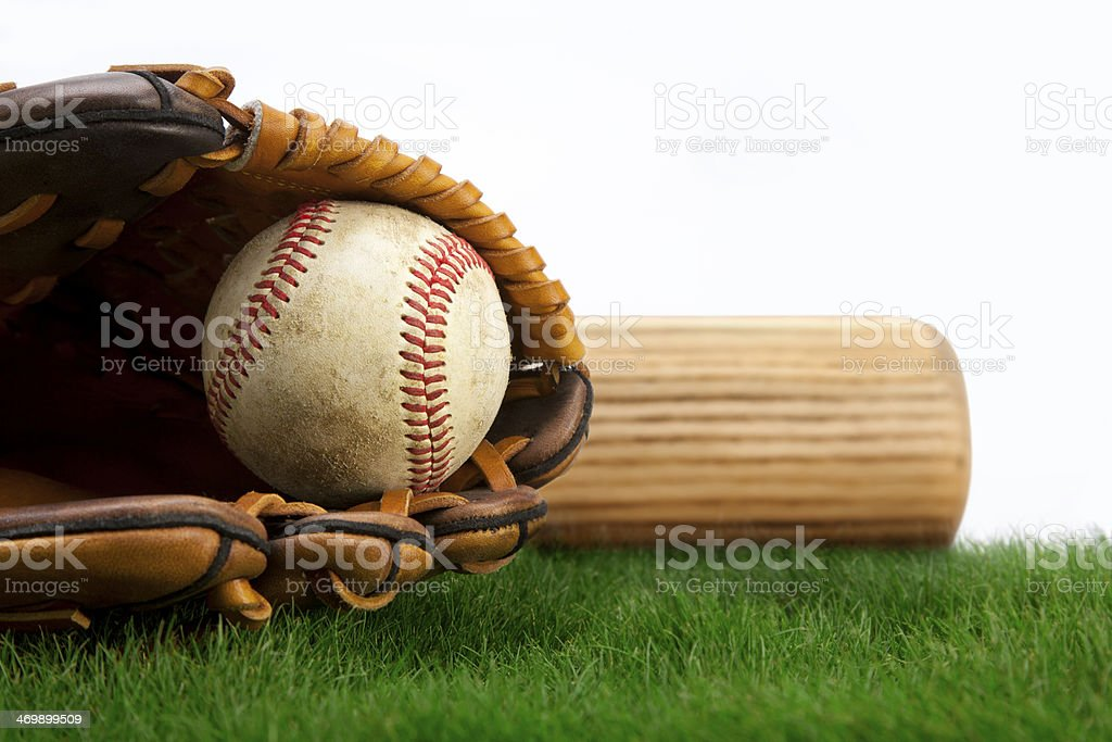 Baseball, glove and bat on grass stock photo