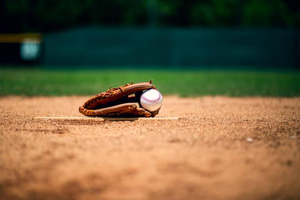 Baseball glove on pitchers mound stock photo