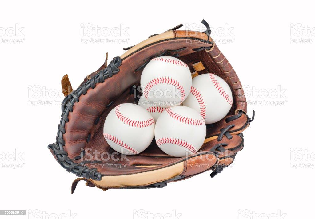 Baseball Glove with four Baseballs. stock photo