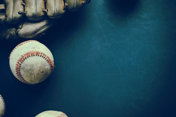 Baseball grunge background with ball and glove. Old baseball with glove flat lay on grunge background with copy space for sports team season. baseball sport stock pictures, royalty-free photos & images