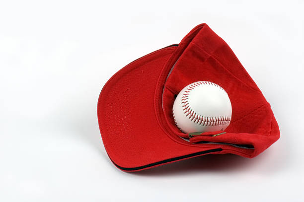 baseball hat with ball - spring training stock photos and pictures
