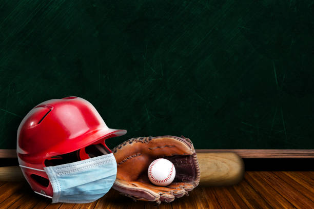 Baseball Helmet Wearing Mask With Chalkboard Background and Copy Space stock photo