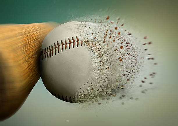 baseball hit with the ball disintegrating stock photo