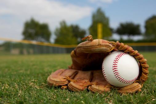 Baseball In A Glove Stock Photo - Download Image Now