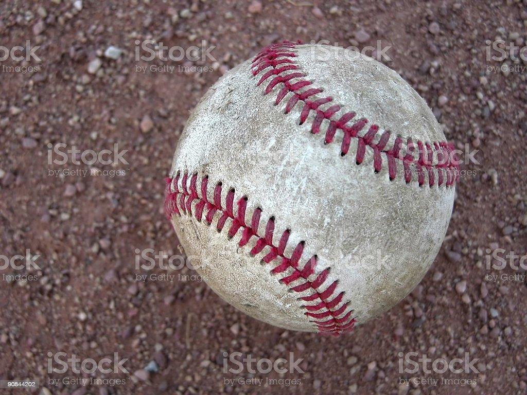 Baseball in Dirt stock photo