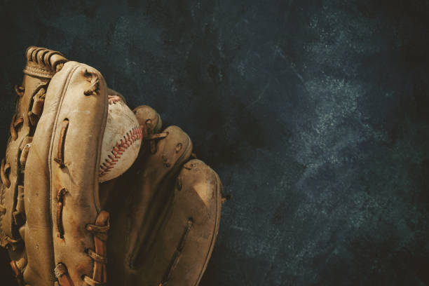 baseball in glove with copy space on dark grunge background. - baseball стоковые фото и изображения