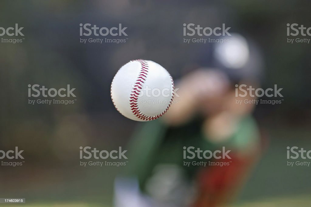 Baseball in mid air after being thrown by pitcher stock photo