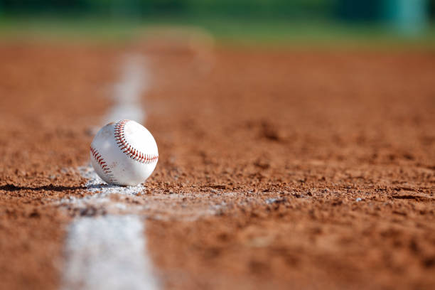 Baseball in the Infield Baseball on the Chalk Line of the Infield infield stock pictures, royalty-free photos & images