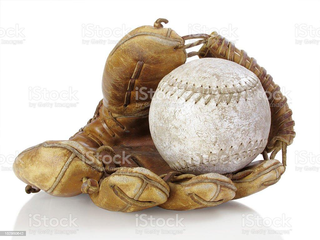 A baseball inside of a baseball glove stock photo