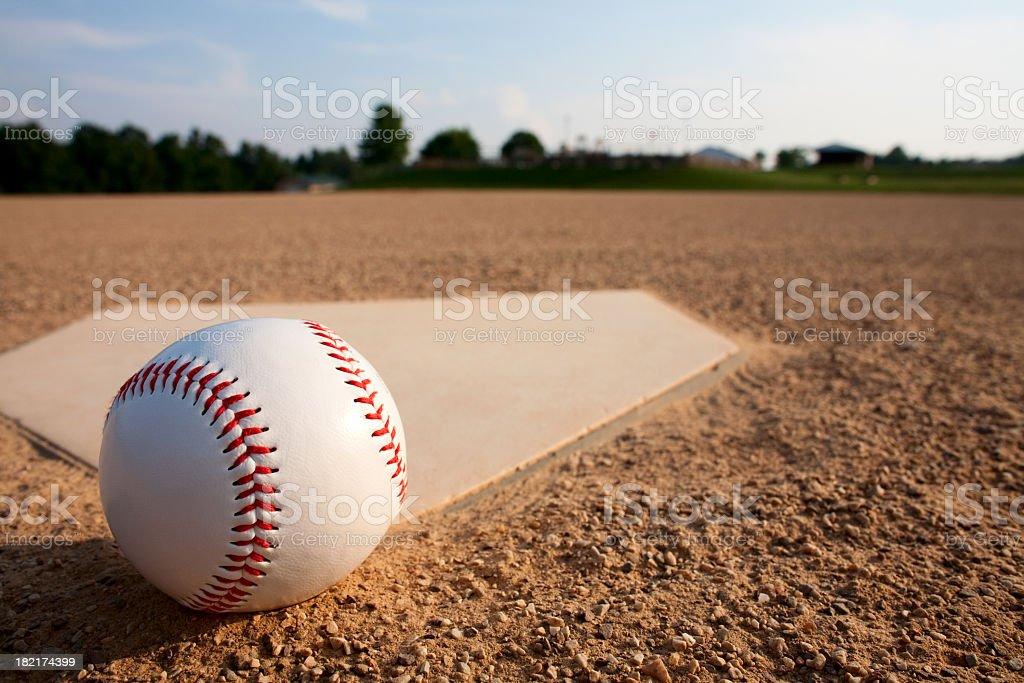 A baseball Near a diamond on a baseball field stock photo