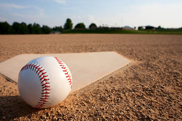 A baseball Near a diamond on a baseball field stock photo