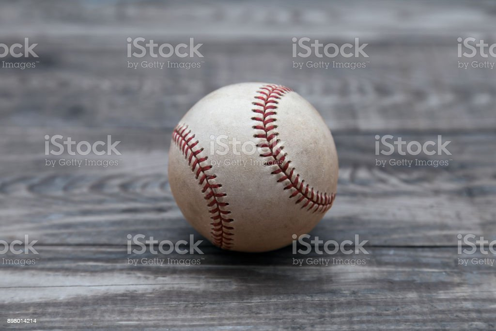 Baseball on a old rustic wooden desk with copy space background stock photo