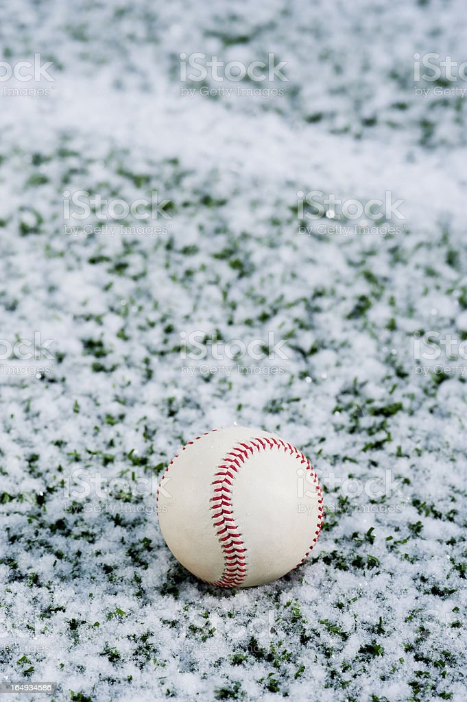 Baseball on a snow field royalty-free stock photo