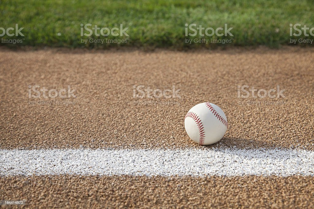 Baseball on base path with grass infield stock photo