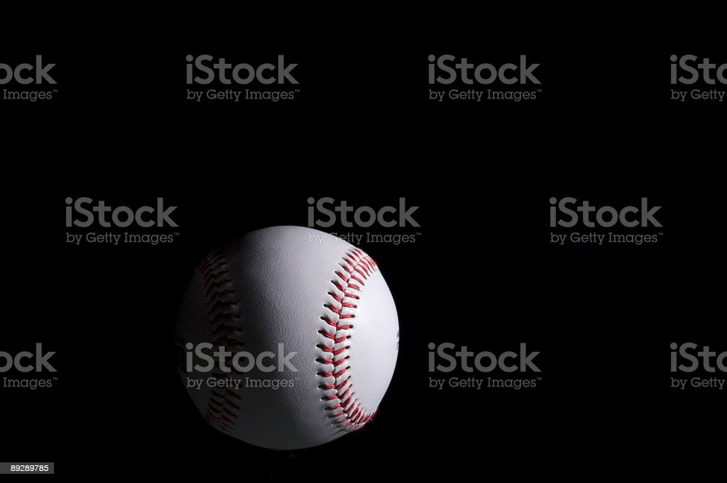 Baseball on black stock photo