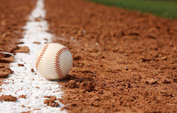 Baseball on Chalk Line of the Field  infield stock pictures, royalty-free photos & images