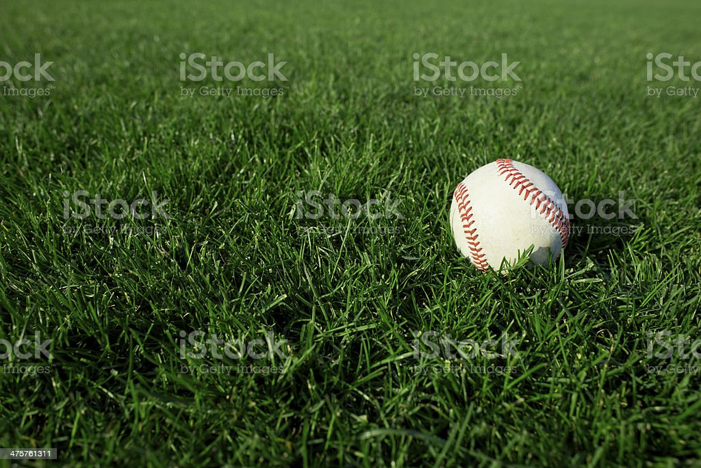 Baseball on field of grass stock photo