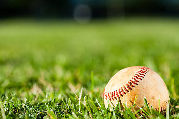 Baseball on Grass Field stock photo