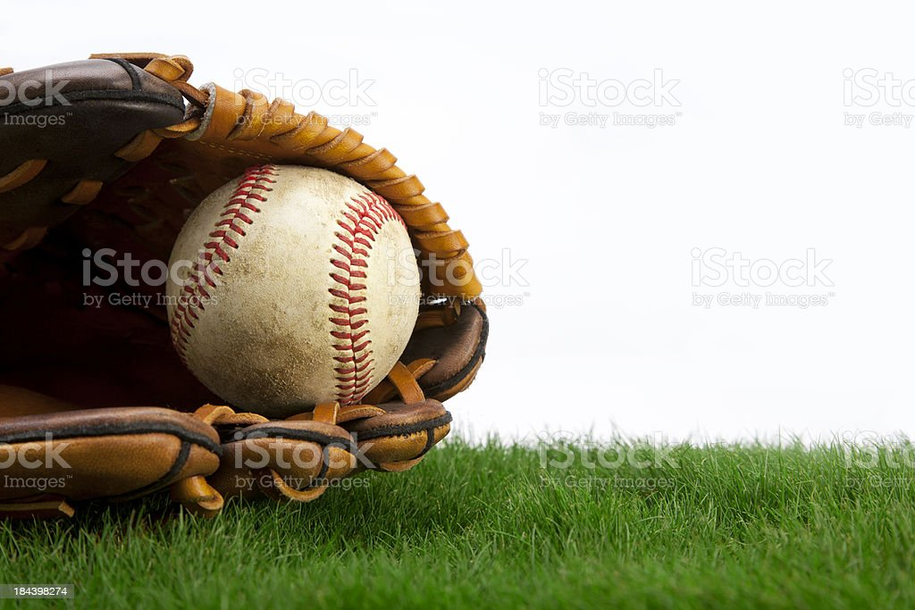Baseball on Grass with Glove stock photo