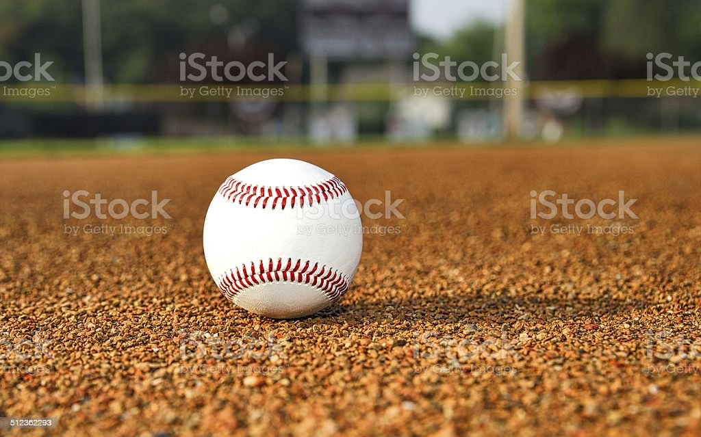 Baseball on Infield Dirt stock photo