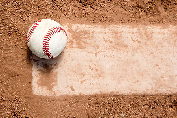 baseball on pitchers mound rubber - spring training stock photos and pictures