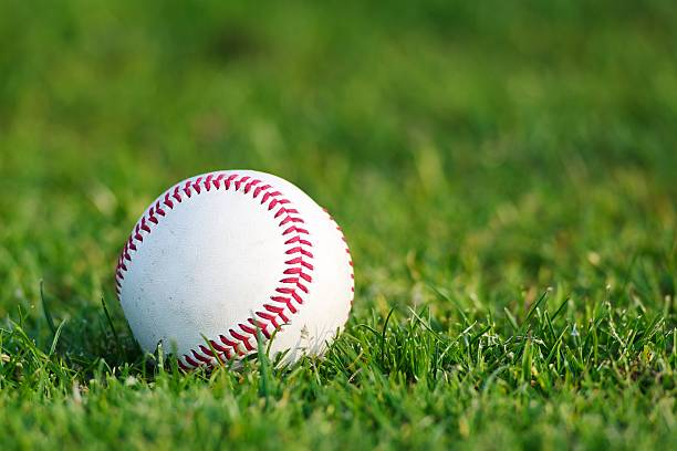 baseball on the grass - spring training stock photos and pictures