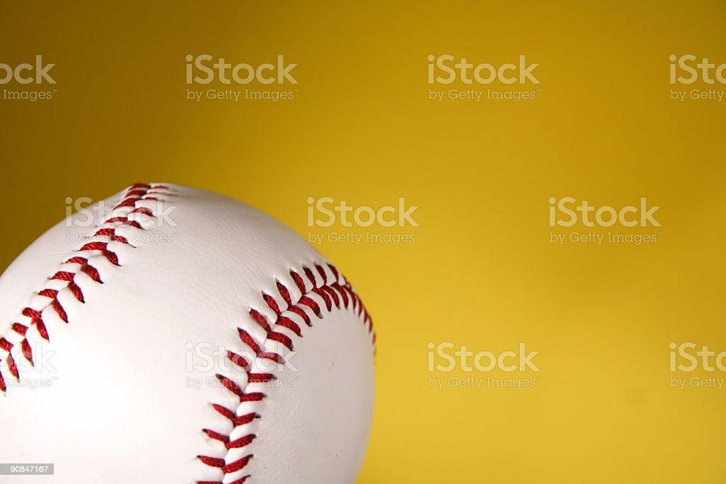 Baseball on yellow background royalty-free stock photo