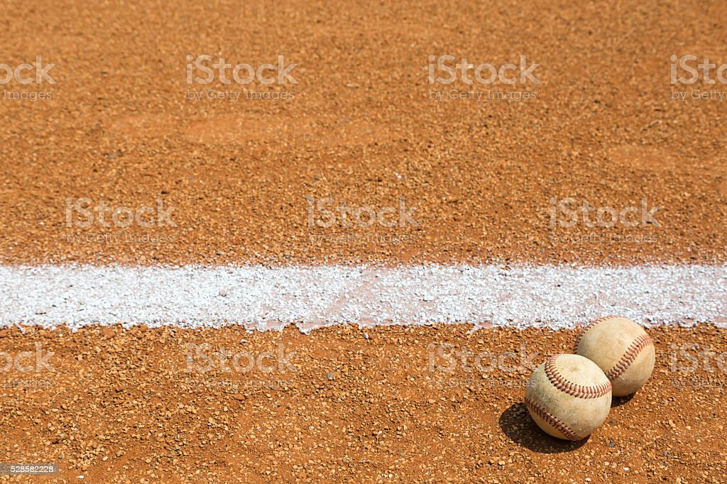 Baseball on a little league baseball field in spring