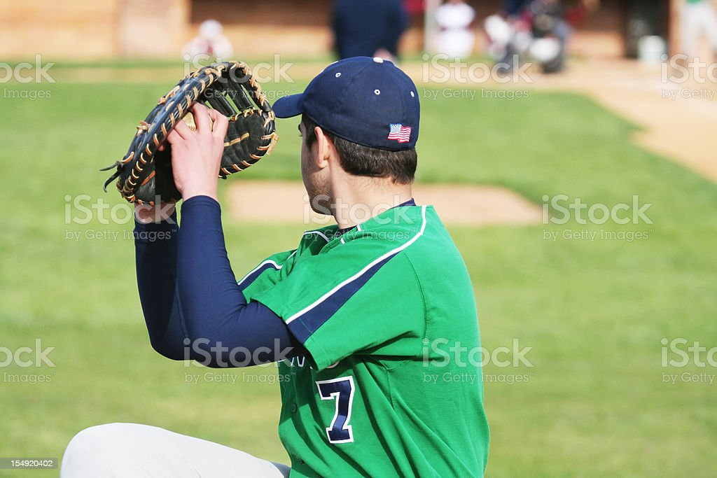 Baseball Pitcher Left Handed Youth Warming Up on Sideline royalty-free stock photo