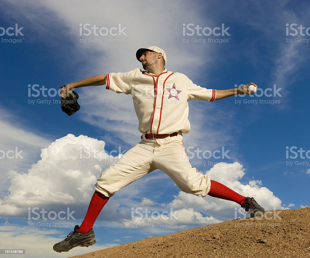 Baseball pitcher on pitcher\'s mound at full stretch about to release...