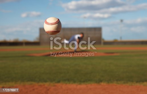 Pitcher tosses ball to home plate