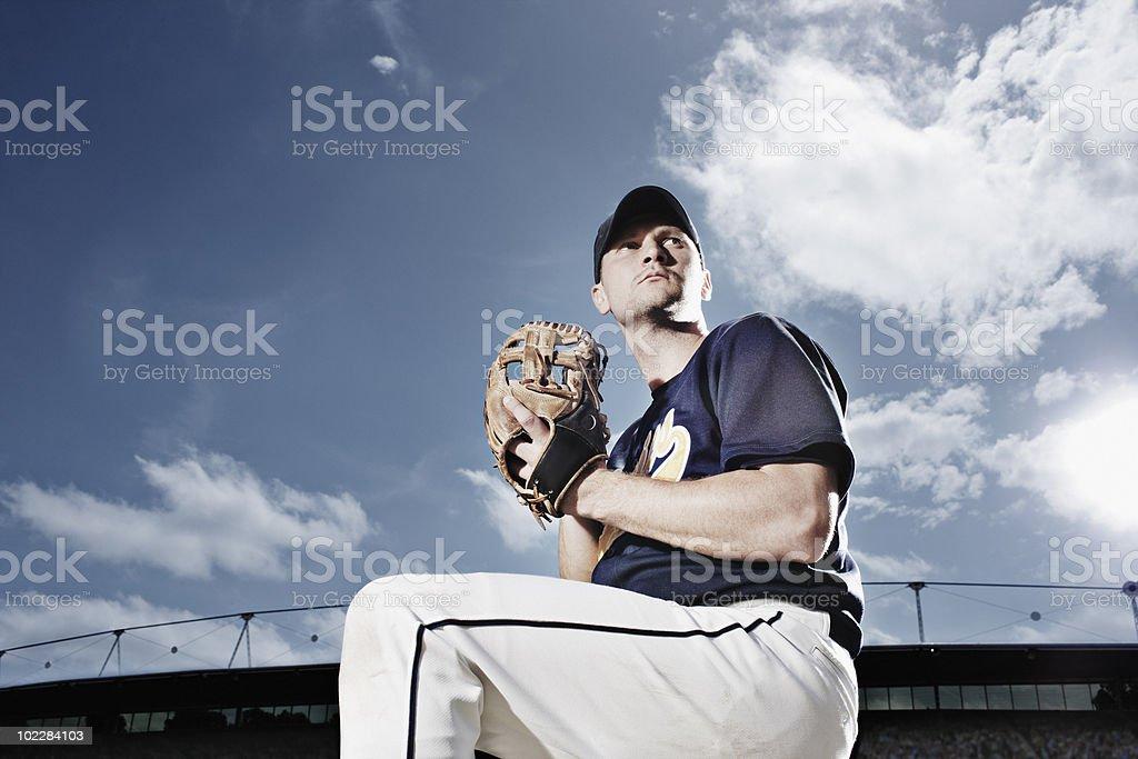 Baseball pitcher preparing to throw ball stock photo