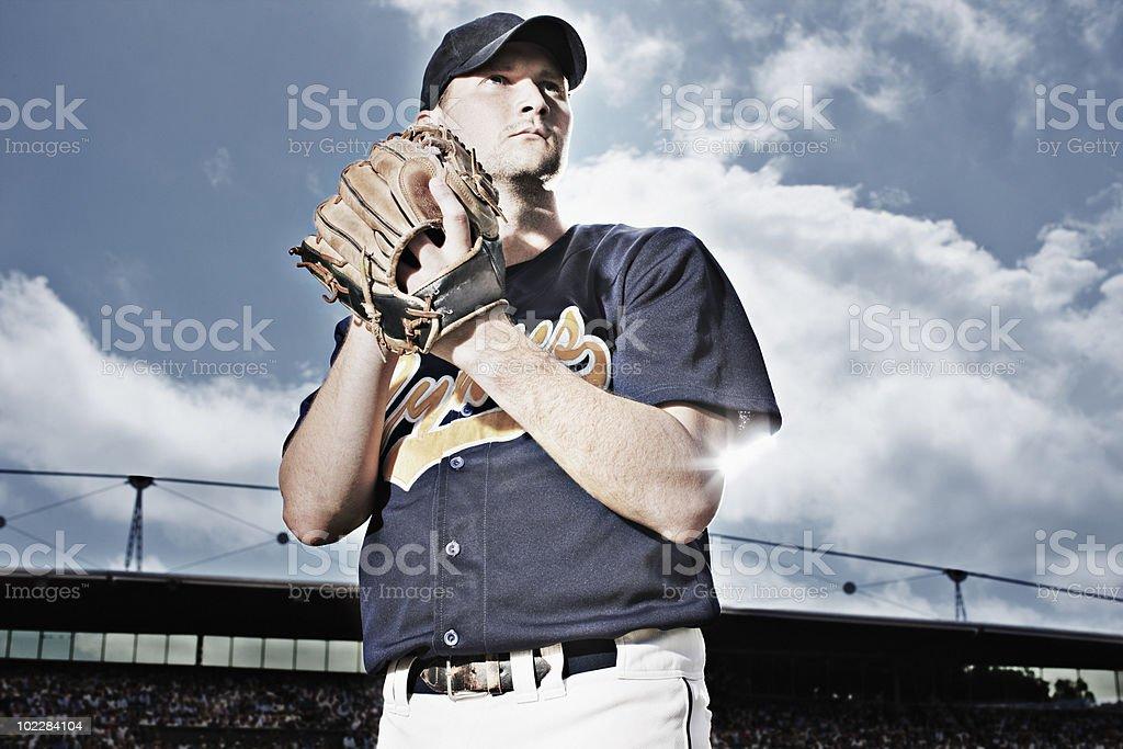 Baseball pitcher preparing to throw ball royalty-free stock photo
