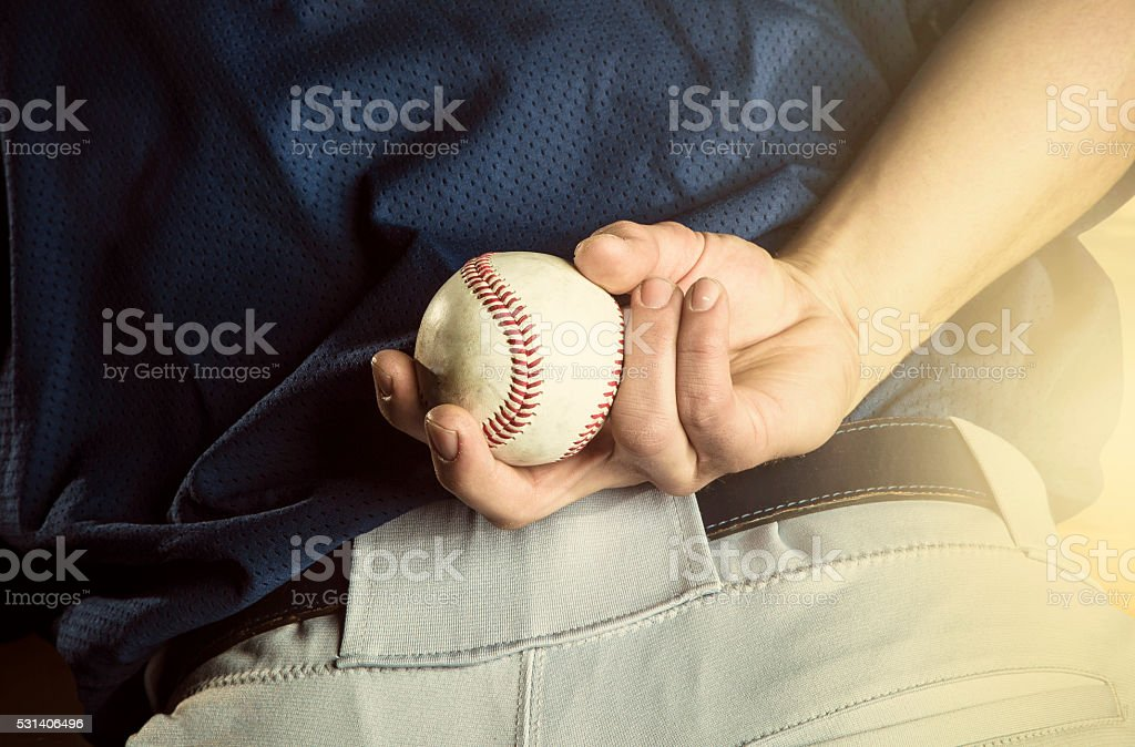 Baseball pitcher ready to pitch. Close up of hand stock photo