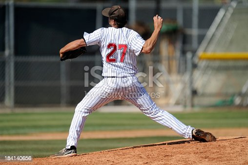 A baseball pitcher throws during a baseball game.