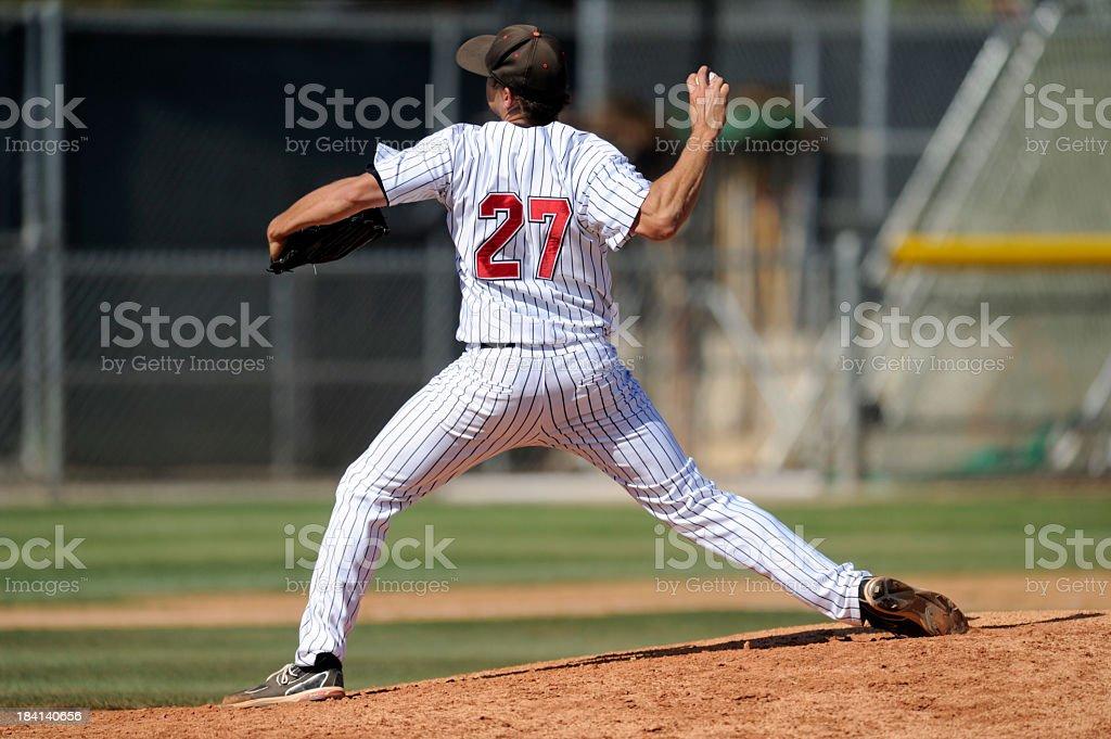 Baseball pitcher throwing the ball stock photo
