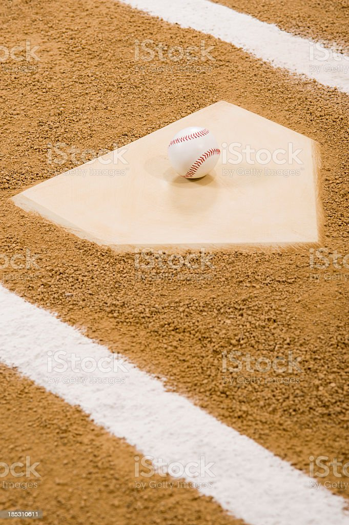 A new Baseball sits on home plate ready for the start of a baseball...