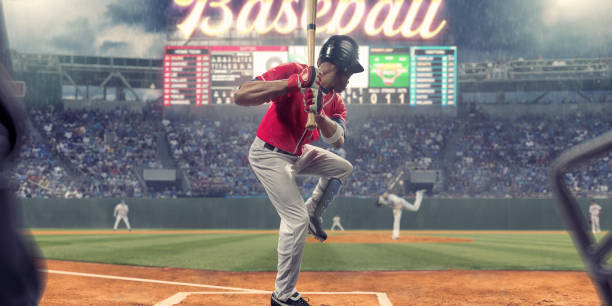 Baseball Player About To Strike Ball During Baseball Game stock photo