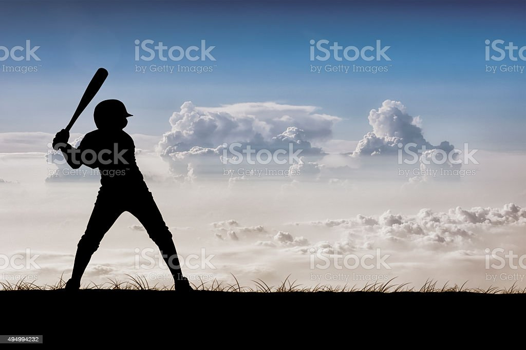 Baseball Player Above the Clouds stock photo