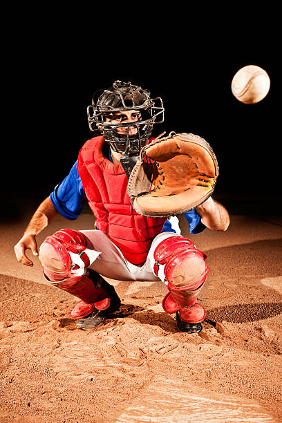 Baseball Player (catcher) at home plate stock photo