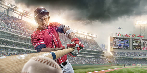Baseball Player Batting Ball in Close Up In Baseball Arena stock photo
