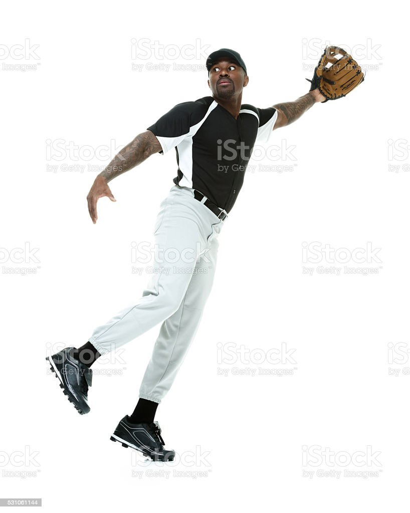 Baseball player catching ball stock photo