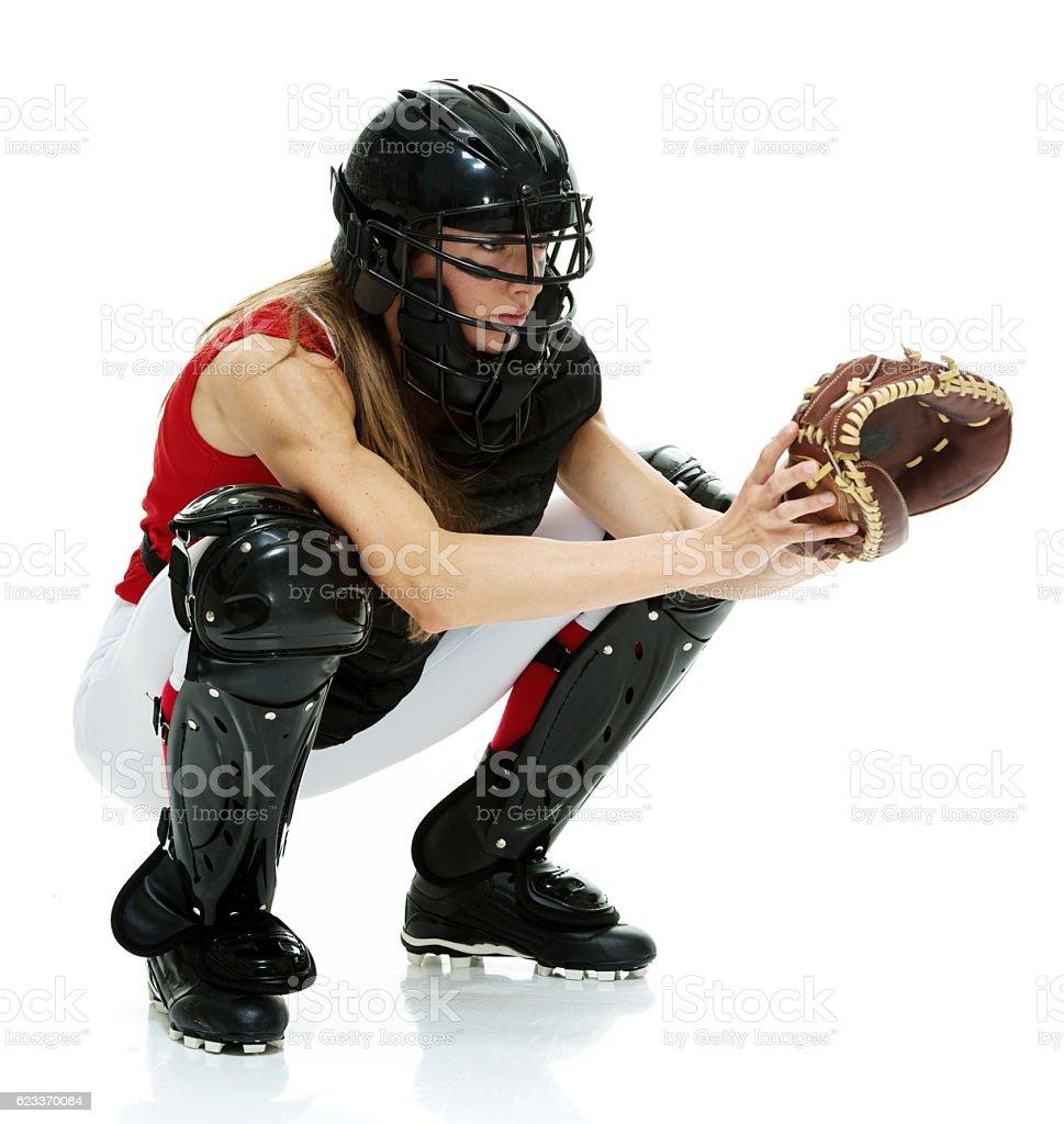 Baseball player crouching stock photo
