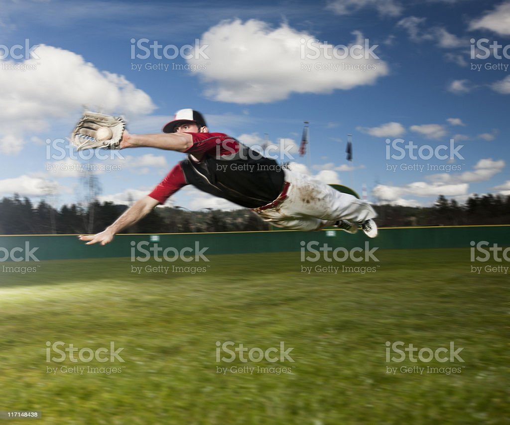 Baseball Player Diving for Catch, Flying in Air, Copy Space stock photo